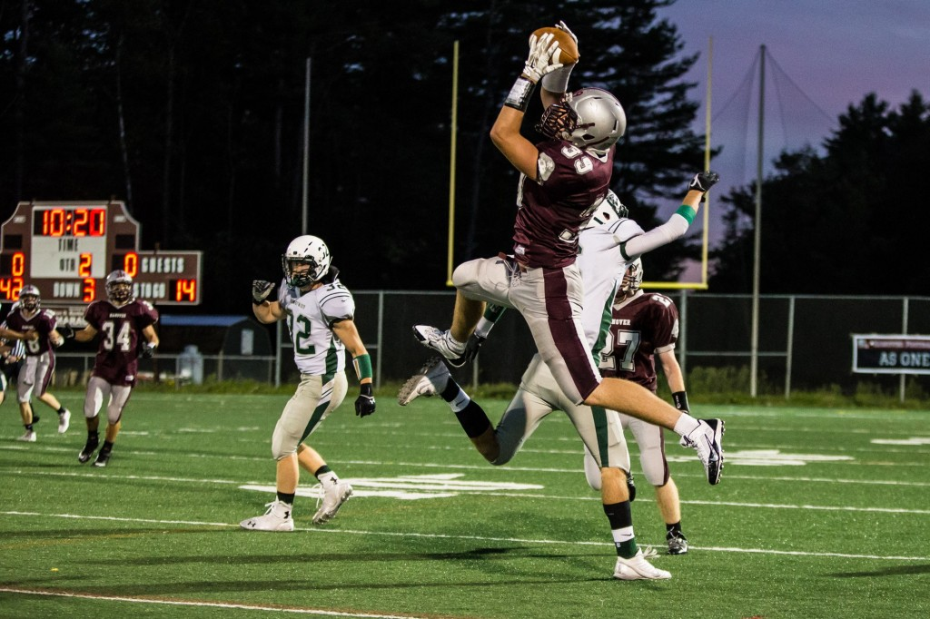 Here #39 Jack Cavallaro jumps over a defender to catch a perfectly thrown ball by quarterback Dom Linehan. Photo taken by Mike Stinson.