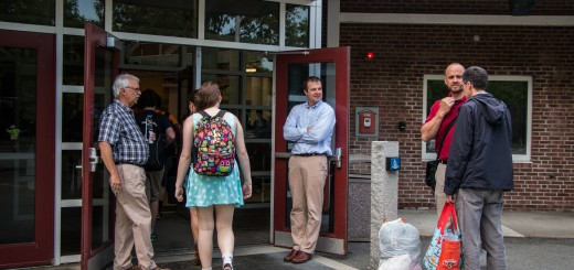 Mr. Smith along with Mr. Wolfe and Mr. Campbell greeting students as they enter the school in the morning.