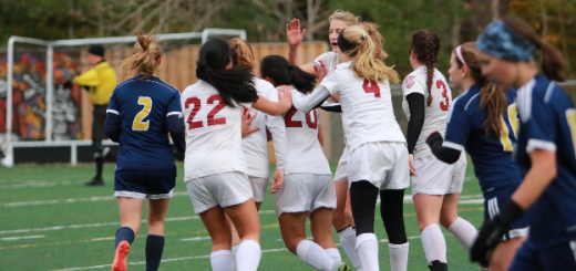 Teammates congratulate Mindy Wu after scoring a goal