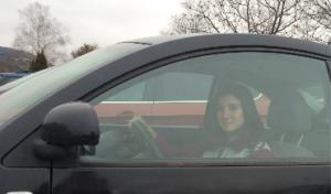 Rediker shown in her Volkswagen Beetle at Woodstock Union High School's parking lot