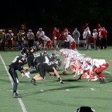The defense waits for the snap at September 1st's varsity football game against Laconia. The Marauders won 16-7.