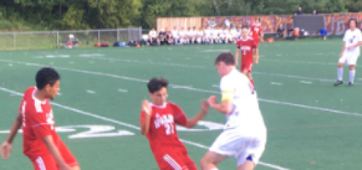 Senior Sam Pych takes on a player from Spaulding High School at Friday's varisty boys soccer game. Hanover won with a 6-0 score.