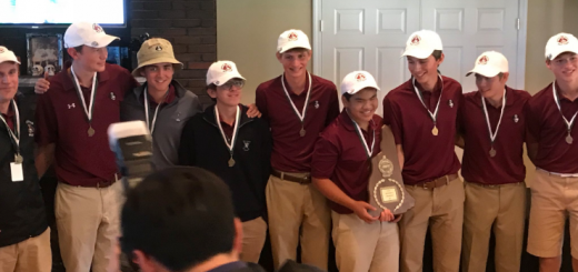 The varsity golf team receives the champions' plaque at Thursday's DII State Championships.