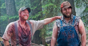 "Tucker and Dale stand covered in blood in ""Tucker & Dale vs Evil"". (Source: http://www.dorkadia.com/2015/08/03/tucker-and-dale/)"