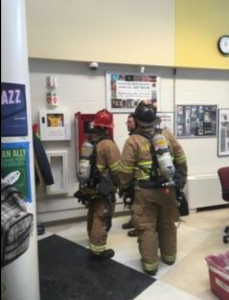 Firefighters check up on HHS following the bathroom fire.