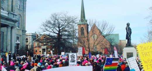 Protesters march in front of New Hampshire's state house in Concord on January 20th in one of many Women's Marches going on across the United States that weekend in protest of some of the recent actions of President Donald Trump's administration and to advocate for local causes in New Hampshire. Photo by Sophie Caulfield ('21).