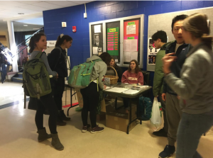 Students submit postcards at HHS earlier this week to send to poltiicians. Their messages call for changes in gun laws. Photograph by Hayden Smith.