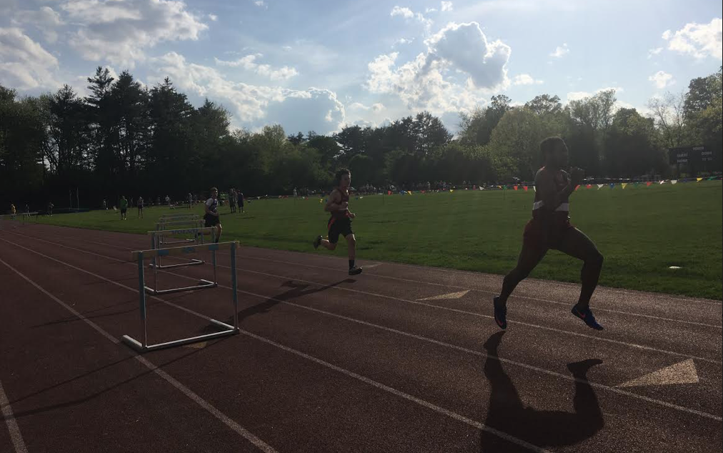 HHS track team members Andrew Chen and Deveon Martin run hurtles at a home meet in Hanover.
