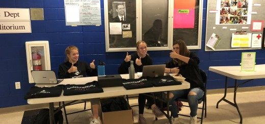 Hanover High Juniors (from left) Anna Stafford, Ella Edmonds, and Katrina Randall selling Homecoming Shirts in the Atrium